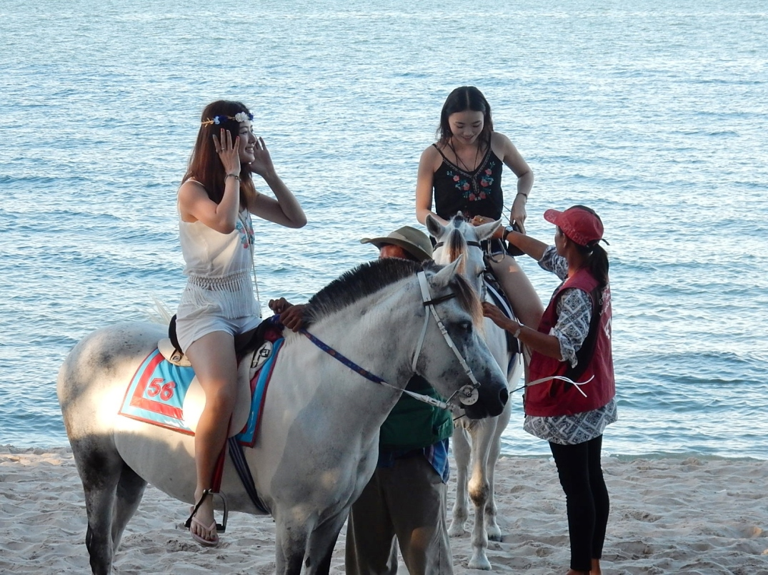 Michael Coghlan; Girls on Horses at Hua Hin beach